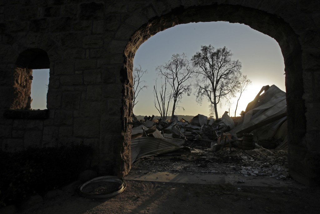 Charred remains of the Soda Rock Winery are framed by the building's stone facade in the aftermath of the Kincade Fire near Healdsburg, Calif., Wednes...