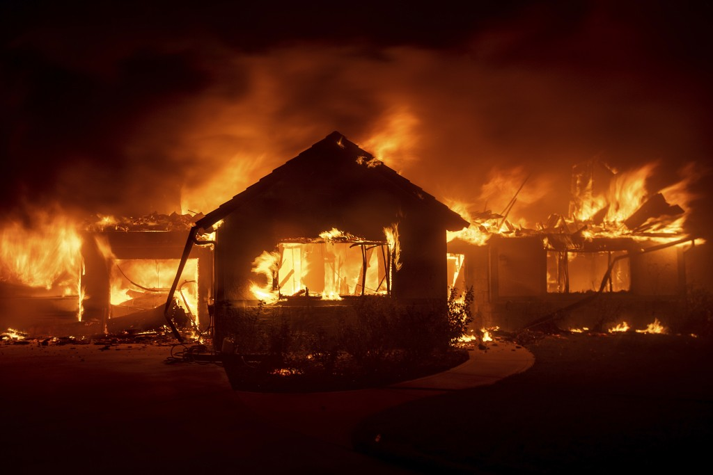 Flames from the Hillside Fire consume a home in San Bernardino, Calif., on Thursday, Oct. 31, 2019. The blaze, which ignited during red flag fire dang...