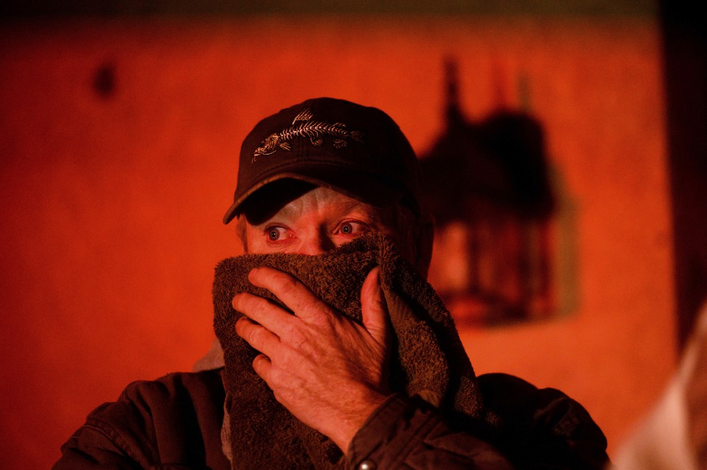 Doug Mac watches as flames from the Hillside fire consume a residence in San Bernardino, Calif., on Thursday, Oct. 31, 2019. The blaze, which ignited ...
