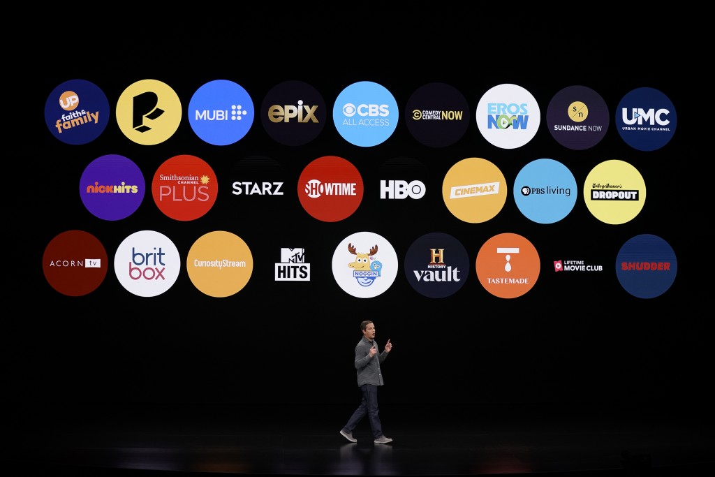 FILE - In this March 25, 2019, file photo Peter Stern, Apple Vice President of Services, speaks at the Steve Jobs Theater during an event to announce ...