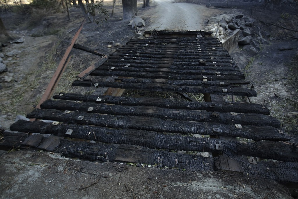 A destroyed bridge leads to a driveway of a property charred in the Kincade Fire near Healdsburg, Calif., Thursday, Oct. 31, 2019. (AP Photo/Charlie R...