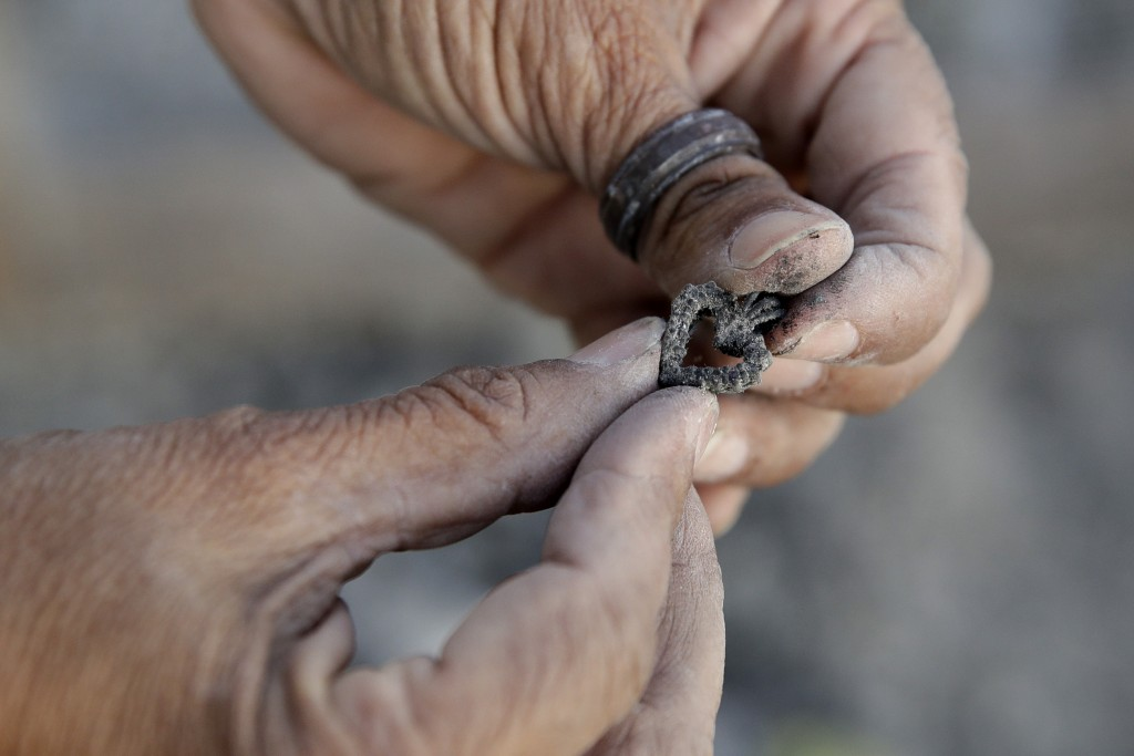 Bernadette Laos looks at jewelry she salvaged from her home that was destroyed by the Kincade Fire near Geyserville, Calif., Thursday, Oct. 31, 2019. ...