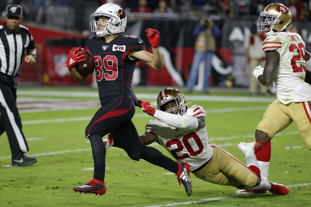 Arizona Cardinals wide receiver Andy Isabella (89) runs for touchdown after the catch as San Francisco 49ers cornerback Jimmie Ward (20) pursues durin...