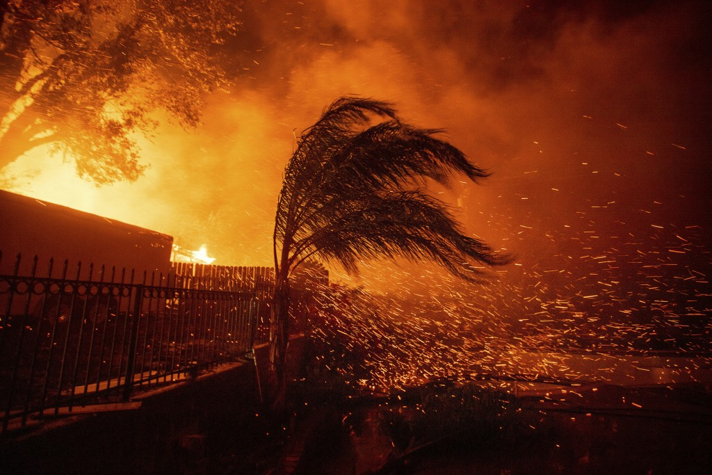 Strong, dry winds send embers flying as the Hillside Fire burns in San Bernardino, Calif., on Thursday, Oct. 31, 2019. The blaze, which ignited during...