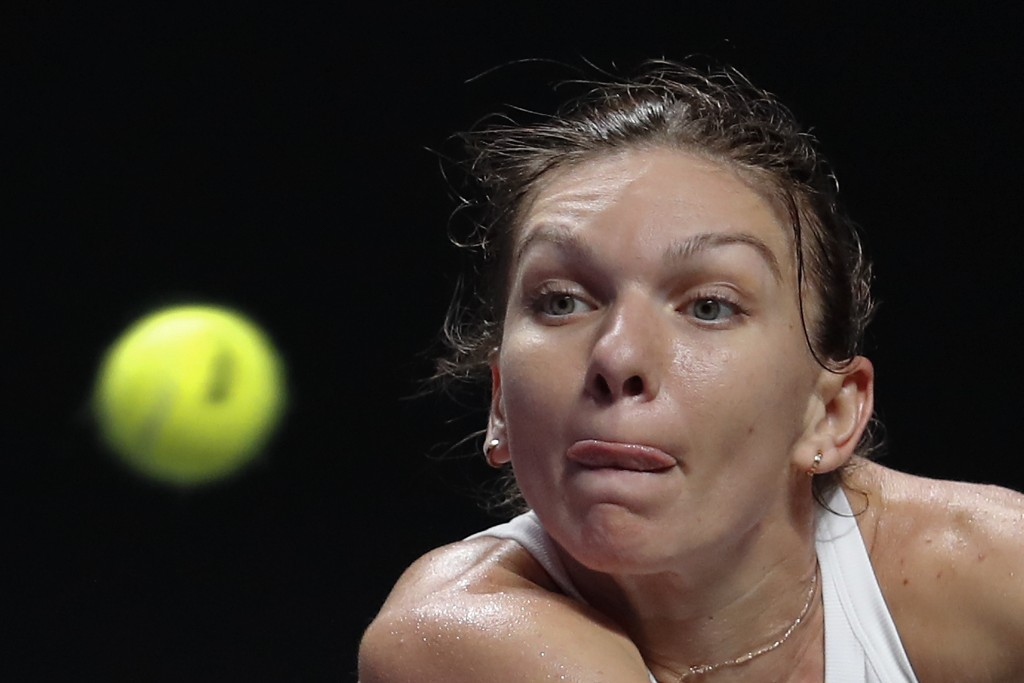 In this Friday, Nov. 1, 2019, file photo, Simona Halep of Romania eyes on the ball as she plays against Karolina Pliskova of the Czech Republic during...