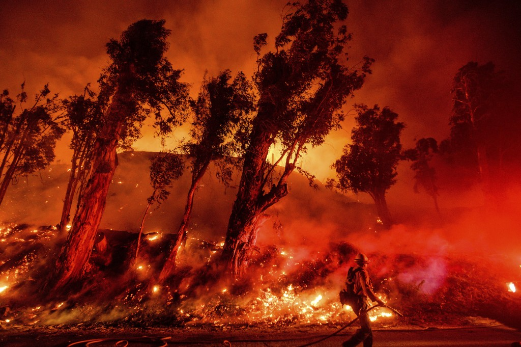 Flames from a backfire consume a hillside as firefighters battle the Maria Fire in Santa Paula, Calif., on Friday, Nov. 1, 2019. According to Ventura ...