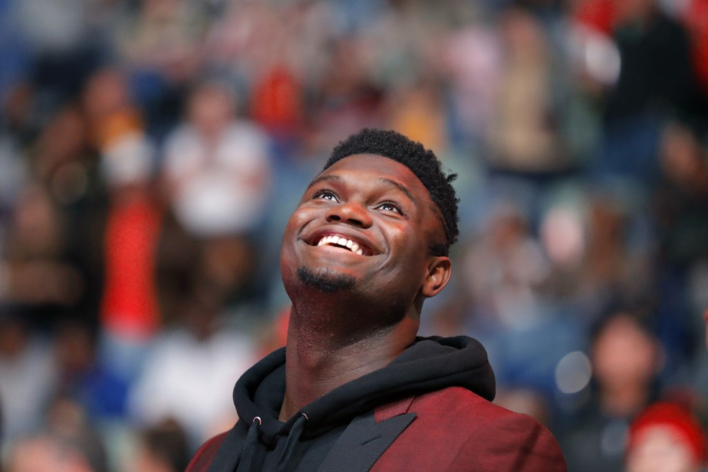 New Orleans Pelicans forward Zion Williamson watches the video screen during a player introduction video before the team's NBA basketball game against...