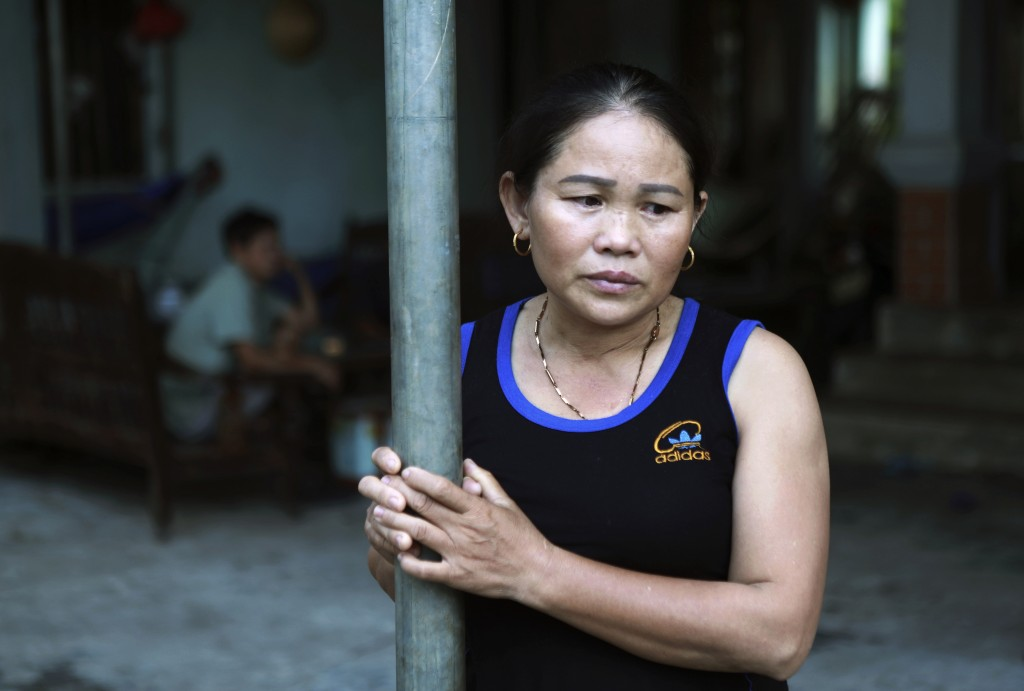 In this Oct. 28, 2019, photo, Hoang Thi Ai, mother of Hoang Van Tiep, who is feared to be among the England truck dead, stares off at home in Dien Thi...