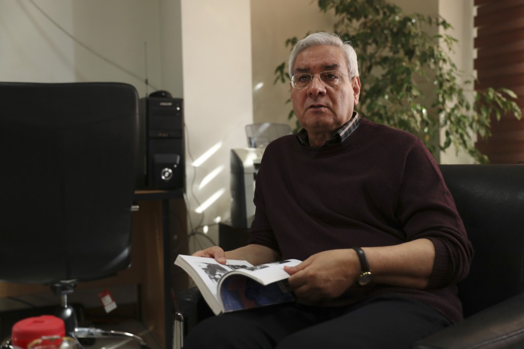 In this Oct. 29, 2019, photo, Ebrahim Asgharzadeh, one of the Iranian student leaders of the 1979 U.S. Embassy takeover, speaks in an interview with T...