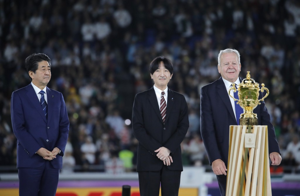 Japan's Prime Minister Shinzo Abe, Japan's Crown Prince Akishino and World Rugby chairman Bill Beaumont, from left, during the presentation ceremony a...