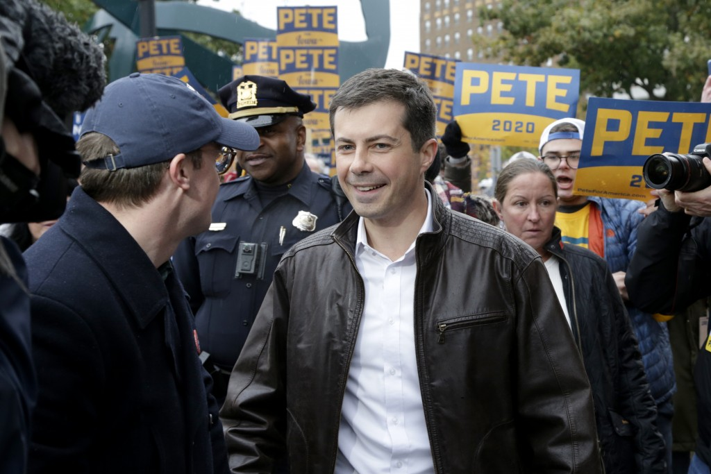 Democratic presidential candidate and South Bend Mayor Pete Buttigieg leads supporters on a march to the Democratic Party's Liberty and Justice Celebr...