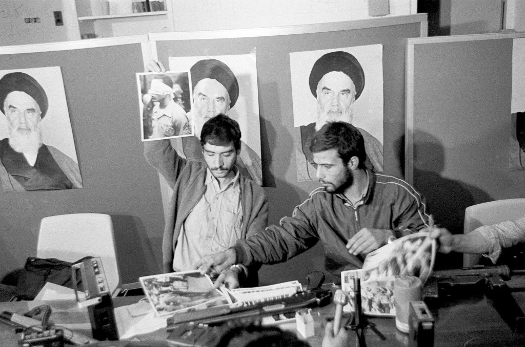 FILE - In this Nov. 5, 1979, file photo, Ebrahim Asgharzadeh, left, a representative of the Iranian students who stormed the U.S. Embassy on Nov. 4, h...