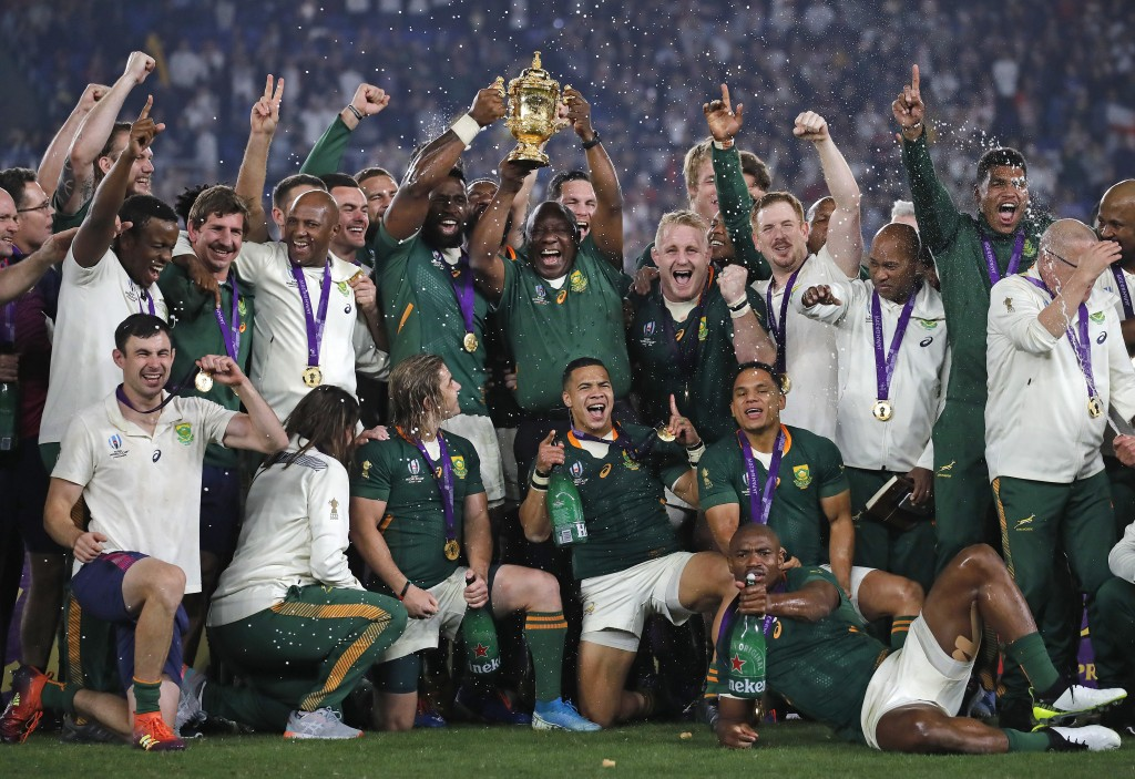 South African captain Siya Kolisi holds the Webb Ellis Cup aloft with South African President Cyril Ramaphosa after South Africa defeated England to w...