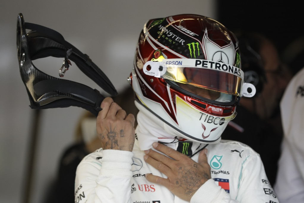 Mercedes driver Lewis Hamilton, of Britain, prepares to drive during the second practice session for the Formula One U.S. Grand Prix auto race at the ...