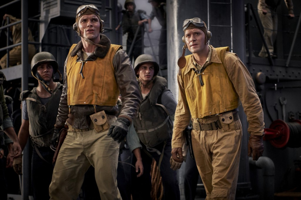 """This image released by Lionsgate shows Ed Skrein, left, and Luke Kleintank in a scene from """"Midway."""" (Reiner Bajo/Lionsgate via AP)"""