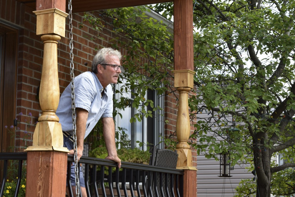 Jacques Mathurin stands on the porch of his his home in Laval, Quebec, Canada on Aug. 12, 2019. Test results revealed lead levels in his drinking wate...