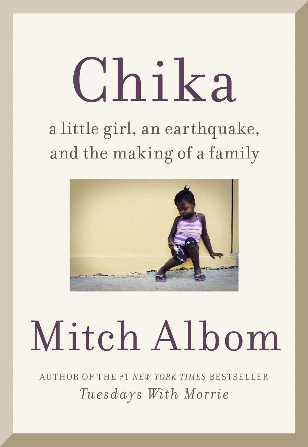 """This cover image released by Harper shows """"Finding Chika: A Little Girl, an Earthquake, and the Making of a Family,"""" by Mitch Albom. (Harper via AP)"""