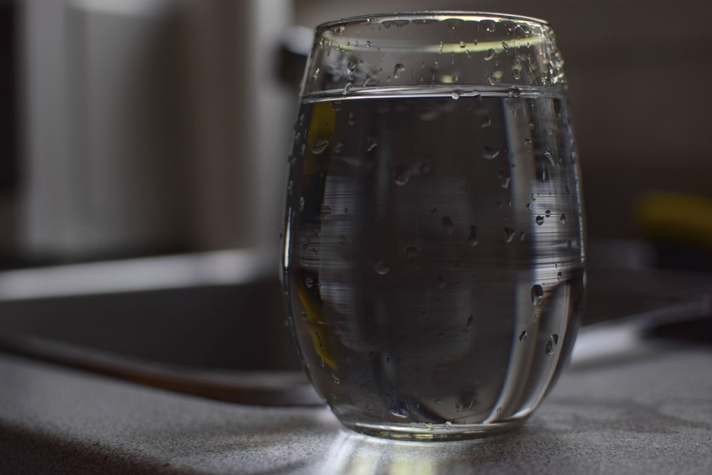 In this July 26, 2019 photo, a glass of tap water sits on a counter in Montreal, Quebec. Hundreds of thousands of Canadians from coast to coast have b...