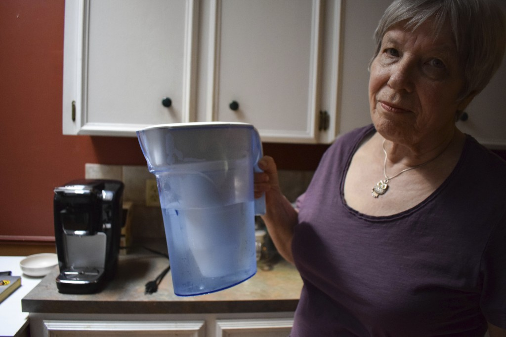 Monica Baehr holds a Zero Water filter for drinking water at her home in Calgary, Alberta, Canada on Aug. 6, 2019. Hundreds of thousands of Canadians ...