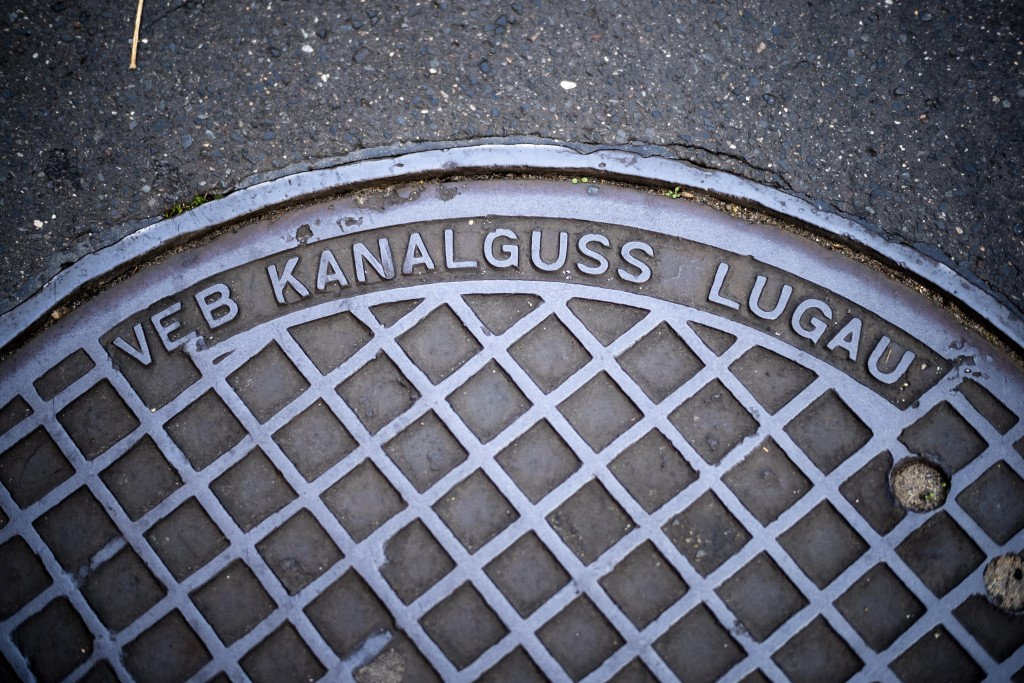 This Thursday, Oct. 31, 2019 photo, shows a manhole cover surviving from communist times in Berlin, when Volkseigene Betriebe, or Publicly Owned Enter...