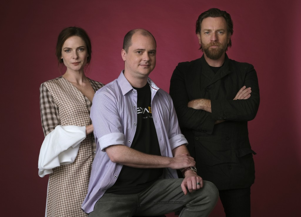 This Oct. 28, 2019 photo shows writer-director Mike Flanagan, center, and actors Rebecca Ferguson, left, and Ewan McGregor posing for a portrait to pr...
