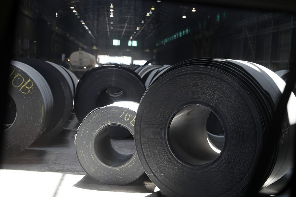 FILE - In this June 28, 2018, file photo, rolls of finished steel are seen at the U.S. Steel Granite City Works facility in Granite City, Ill. Preside...