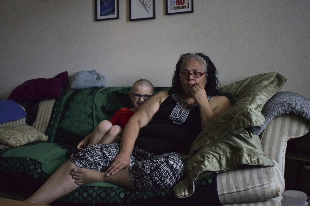 Leona Peterson and her son, Wayne, 6, sit in their home in Prince Rupert, British Columbia, Canada. When Peterson moved into the subsidized Indigenous...