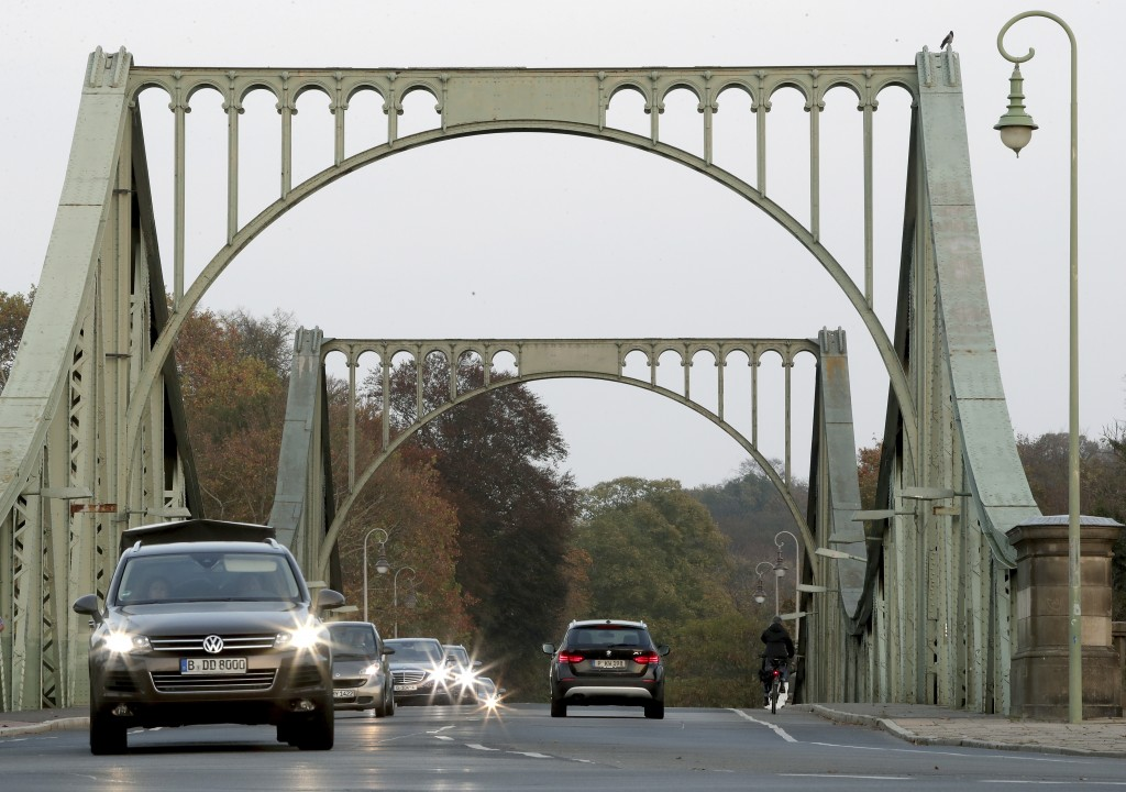 In this Wednesday, Oct. 23, 2019 photo cars drive on the 'Glieniker Bruecke' (Glienicke Bridge) in Potsdam, Germany. During the Cold War, the Glienick...