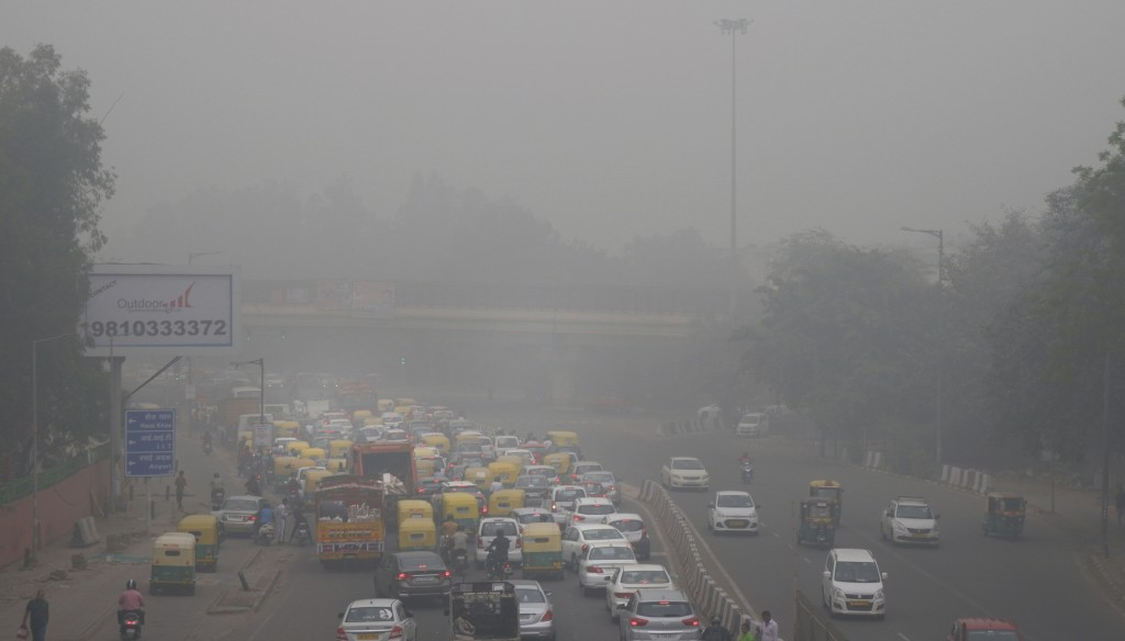 In this Sunday, Nov. 3, 2019, file photo, vehicles wait for a signal at a crossing as the city enveloped in smog in New Delhi, India. Authorities in N...