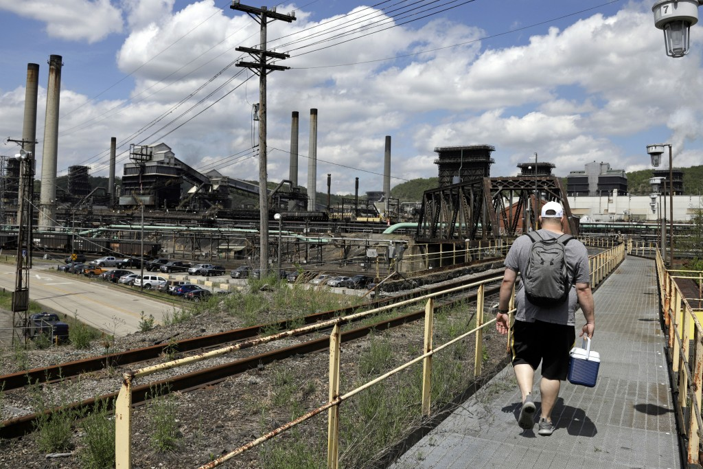 FILE - In this May 2, 2019, file photo a worker arrives for his shift at the U.S. Steel Clairton Coke Works in Clairton, Pa. (AP Photo/Gene J. Puskar,...
