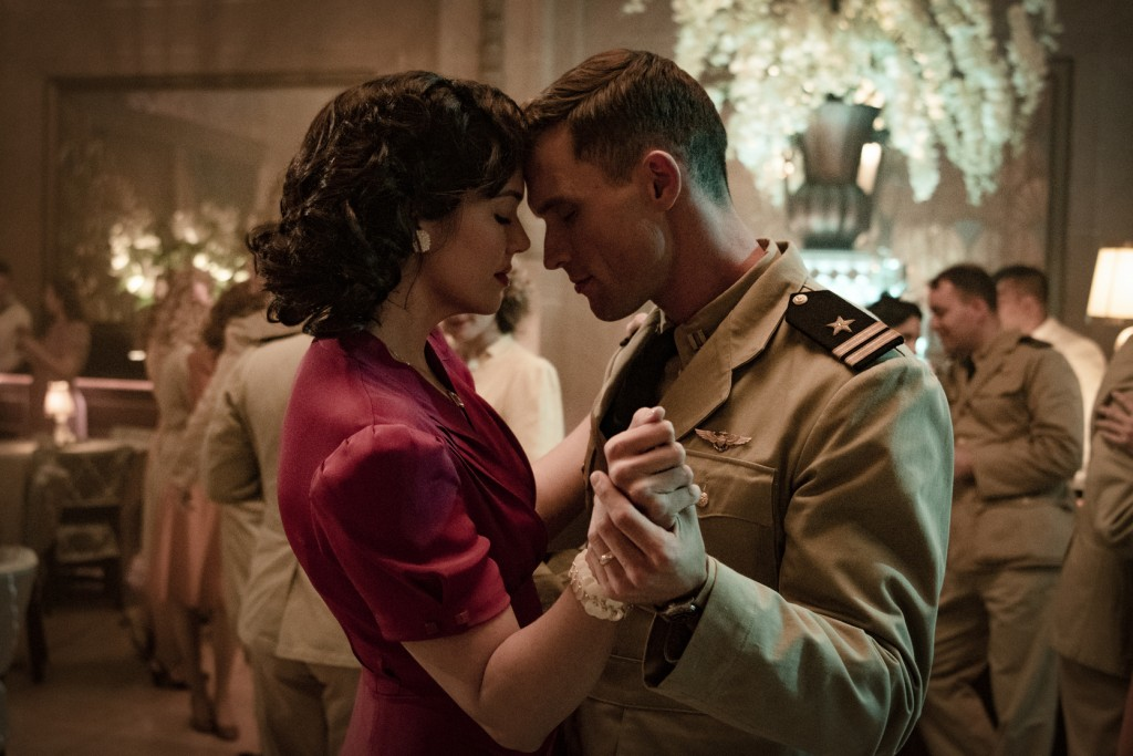 """This image released by Lionsgate shows Mandy Moore, left, and Ed Skrein in a scene from """"Midway."""" (Reiner Bajo/Lionsgate via AP)"""