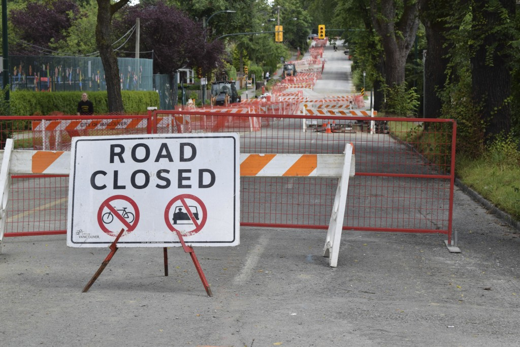 A section of East 12th Avenue is closed off while the City of Vancouver replaces a water main on July 14, 2019. According to the City, the existing wa...