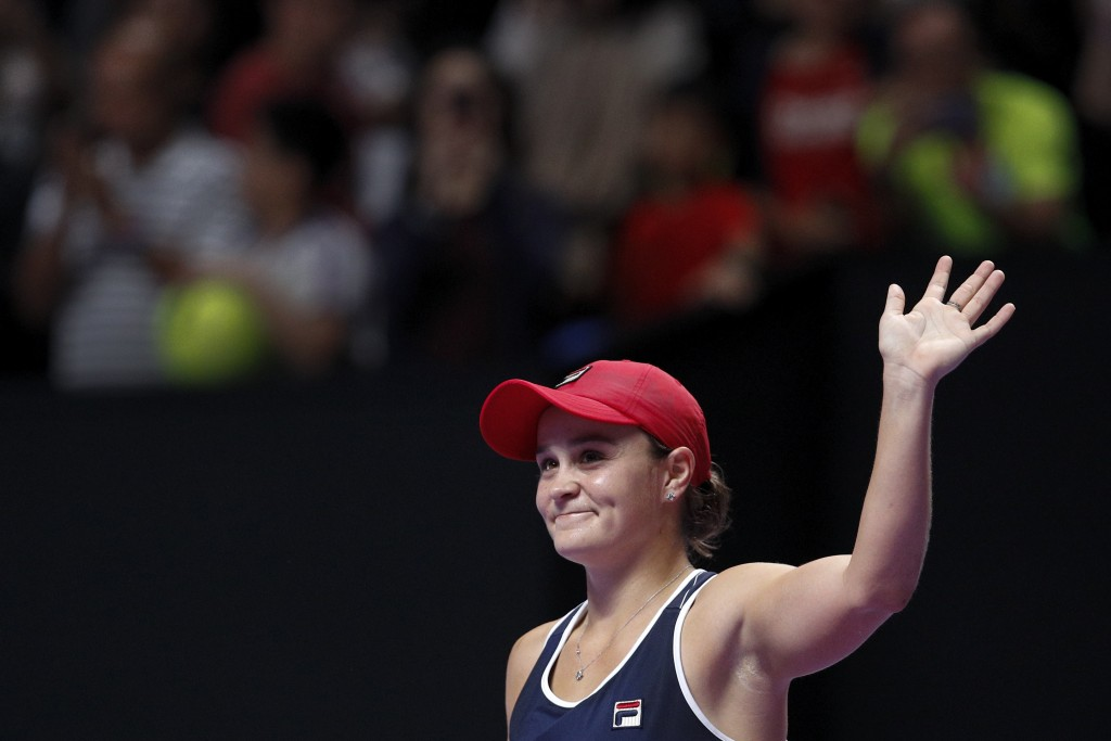 Ashleigh Barty of Australia waves to the spectators after defeating Elina Svitolina of Ukraine in the WTA Finals Tennis Tournament at the Shenzhen Bay...