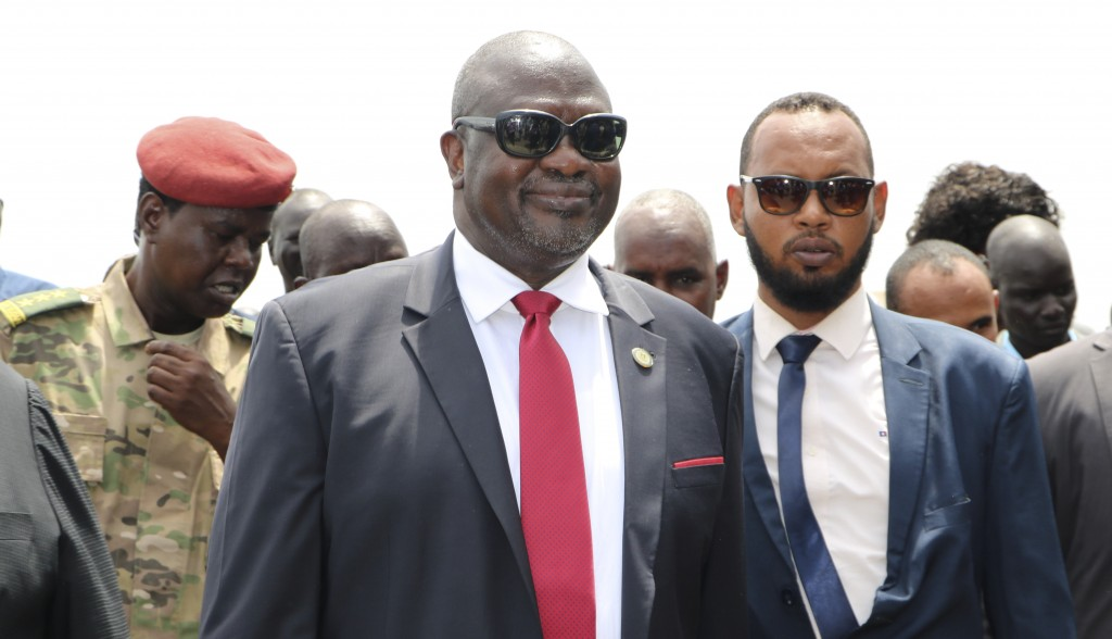 FILE - In this Saturday, Oct. 19, 2019 file photo, South Sudan's opposition leader Riek Machar, center, returns to the country, in Juba, South Sudan. ...