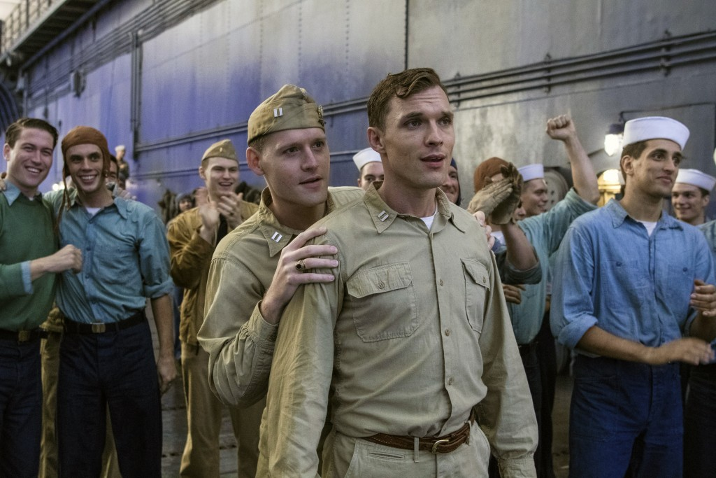 """This image released by Lionsgate shows Luke Kleintank, foreground left, and Ed Skrein in a scene from """"Midway."""" (Reiner Bajo/Lionsgate via AP)"""