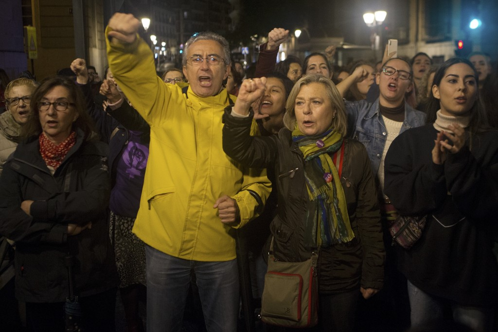 Protesters shout outside the Justice Ministry in Madrid, Spain, Monday, Nov. 4, 2019. Thousands in Spain are demonstrating to demand changes in crimin...