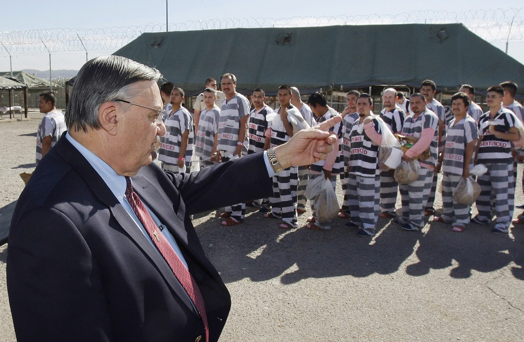 FILE - In this Feb. 4, 2009, file photo, Maricopa County Sheriff Joe Arpaio, left, orders approximately 200 convicted illegal immigrants handcuffed to...
