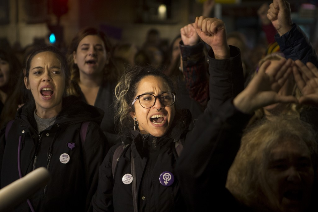 Women shout outside the Justice Ministry in Madrid, Spain, Monday, Nov. 4, 2019. Thousands in Spain are demonstrating to demand changes in criminal la...