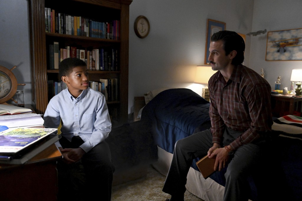 """This image released by NBC shows Lonnie Chavis as Randall, left, and Milo Ventimiglia as Jack, in a scene from """"This Is Us,"""" airing on Tuesday at 9 p...."""