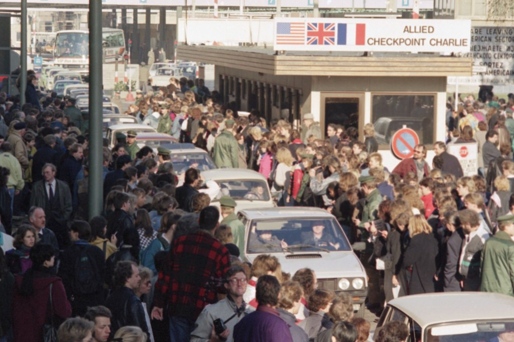 In this Friday Nov. 10, 1989 file photo East German citizens are applauded by West Berliners when they cross Checkpoint Charlie with their cars to vis...