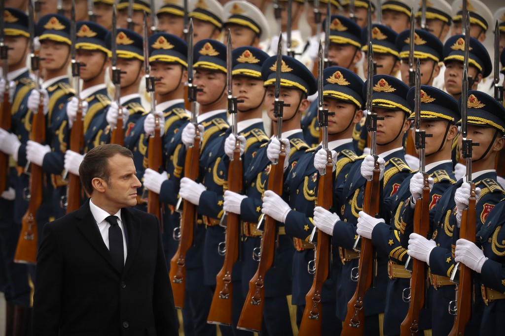 French President Emmanuel Macron reviews a Chinese honor guard during a welcome ceremony at the Great Hall of the People in Beijing, Wednesday, Nov. 6...