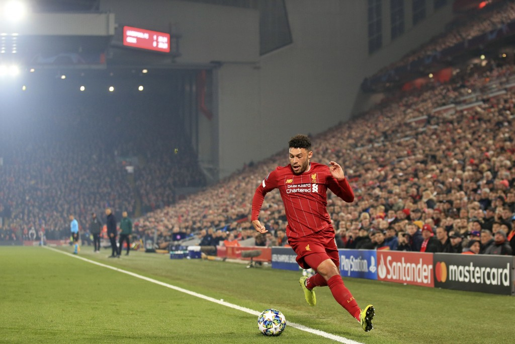Liverpool's Alex Oxlade-Chamberlain runs with the ball during the Champions League group E soccer match between Liverpool and Genk at Anfield Stadium,...