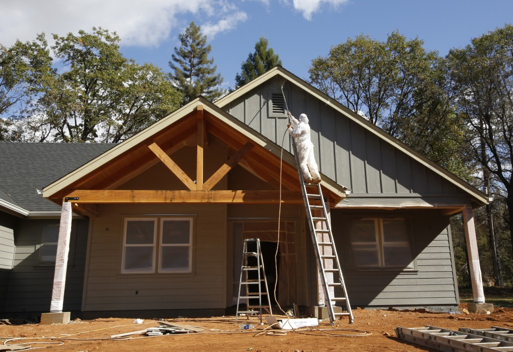 In this photo taken Thursday, Oct. 17, 2019, a home under construction is painted in Paradise, Calif. Only a handful of homes have been rebuilt in the...