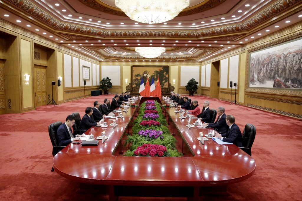 French President Emmanuel Macron and China's President Xi Jinping hold a meeting at the Great Hall of the People in Beijing, China, Wednesday, Nov. 6,...
