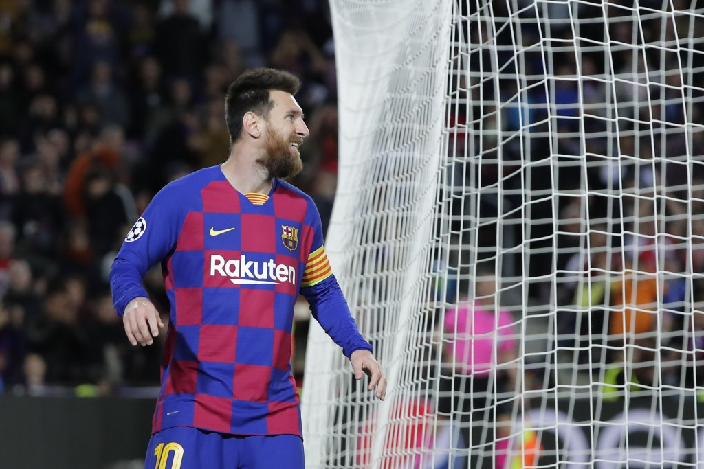 Barcelona's Lionel Messi reacts after missing a chance to score during a Champions League group F soccer match between Barcelona and Slavia Praha at C...