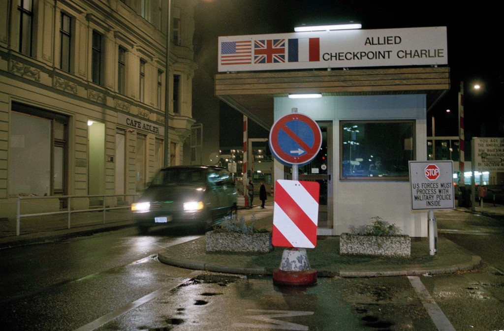 File - In this Thursday Nov. 9, 1989 file photo Checkpoint Charlie border crossing in West Berlin is pictured hours before Communist East Berlin annou...