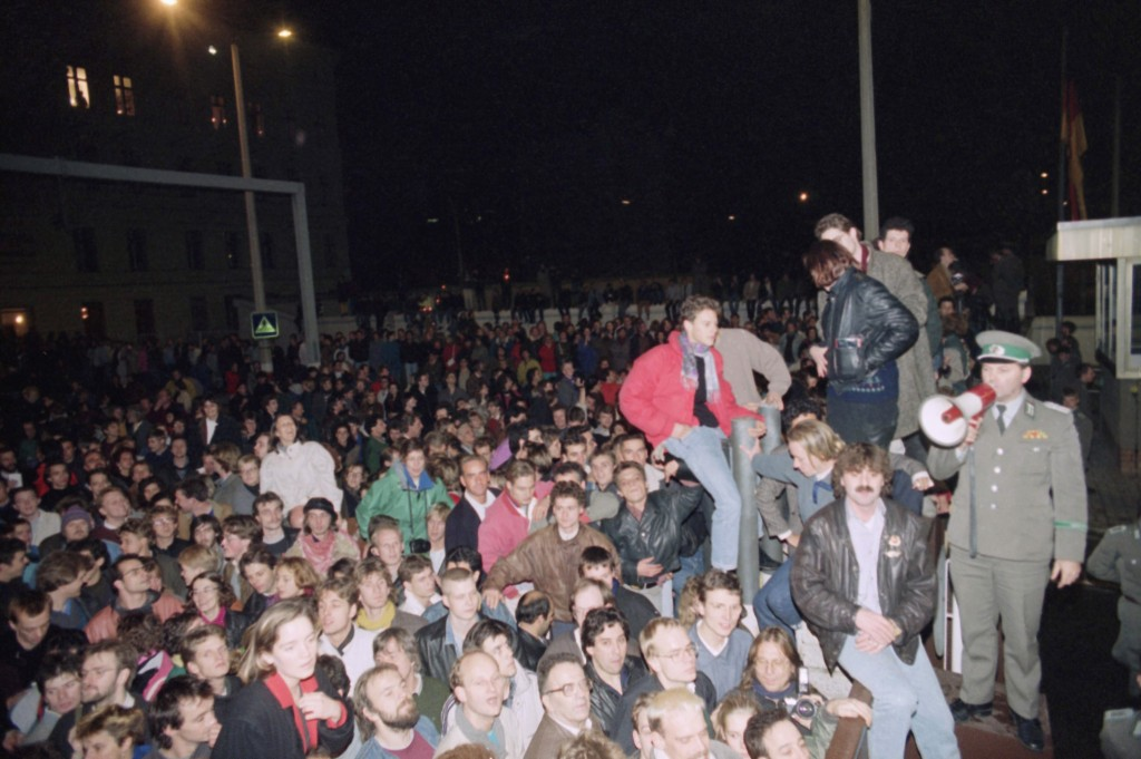 FILE - In this Friday Nov. 10, 1989 file photo, Berliners from East and West crowd the area in front of a border fence at this border crossing point i...