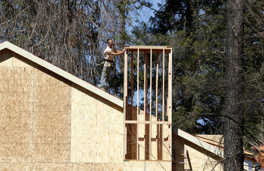 In this Friday, Oct. 18, 2019, photo, a home is rebuilt after the last year's Camp Fire in Paradise, Calif. Only a handful of homes have been rebuilt ...