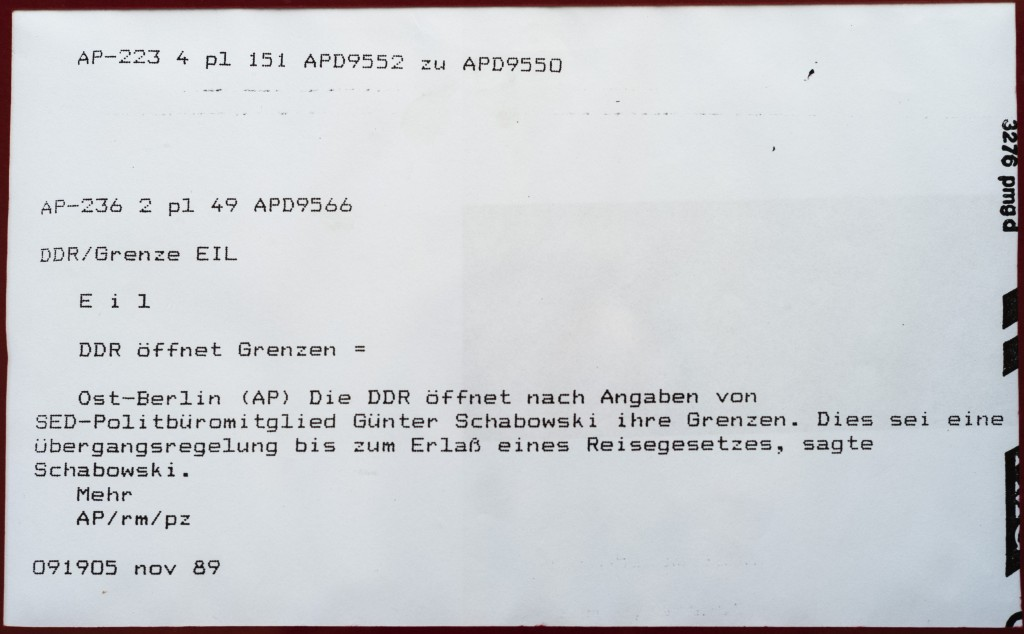 """This Oct. 31, 2019 photo shows an original print from iconic Associated Press German service news alert, """"DDR oeffnet Grenze,"""" or """"East Germany opens ..."""