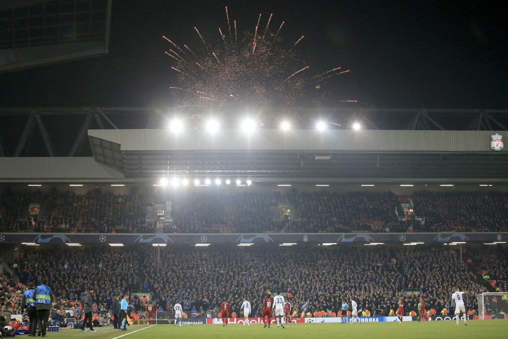 Guy Fawkes Night fireworks go off outside the stadium during the Champions League group E soccer match between Liverpool and Genk at Anfield Stadium, ...